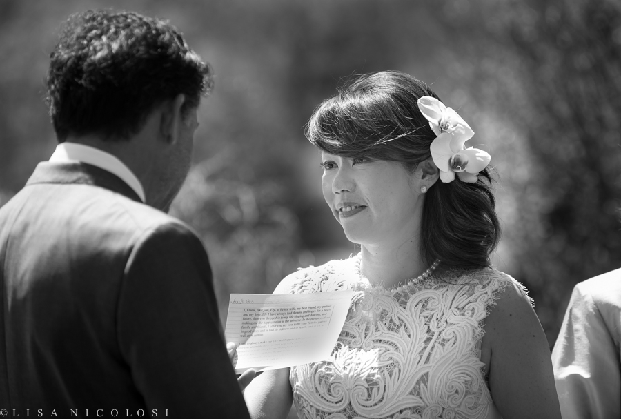 Ely & Frank reading their personally written wedding vows