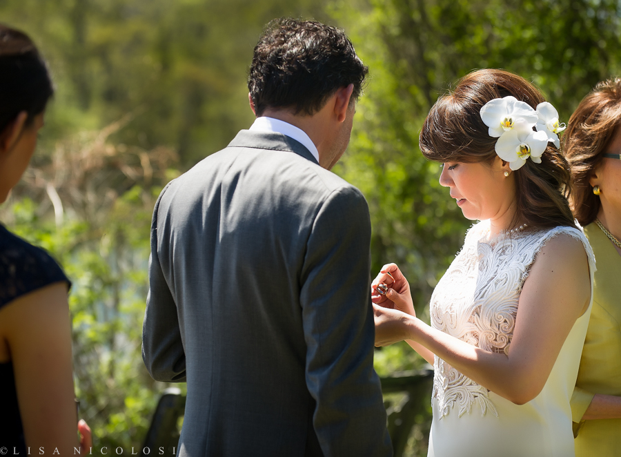 Long Island Outdoor Wedding Ceremony as Ely & Frank exchange wedding rings