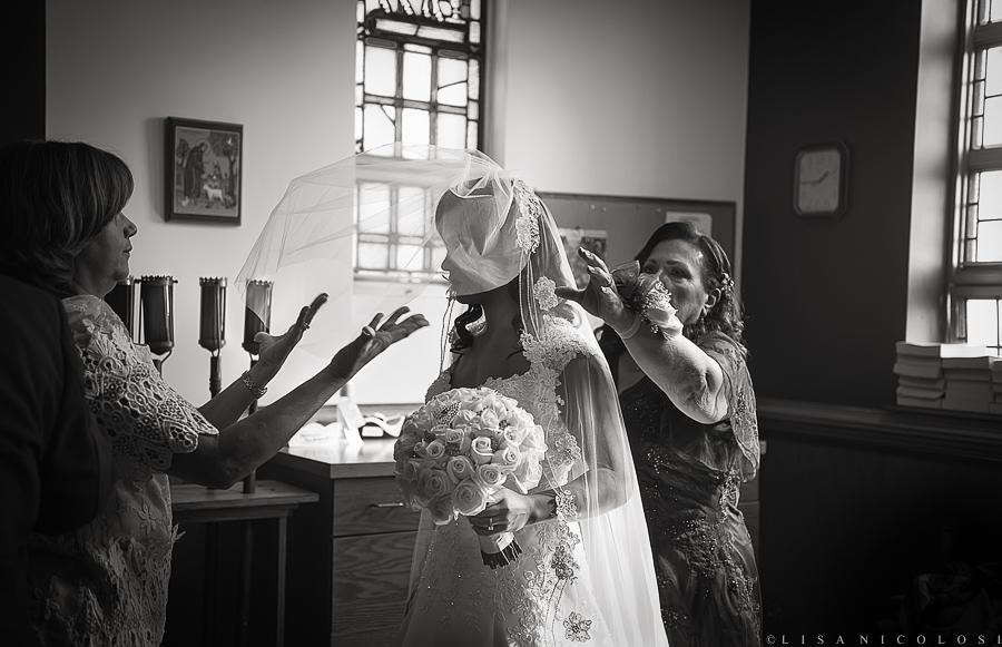 Long Island Wedding Photographer - Bride in Church Vestibule