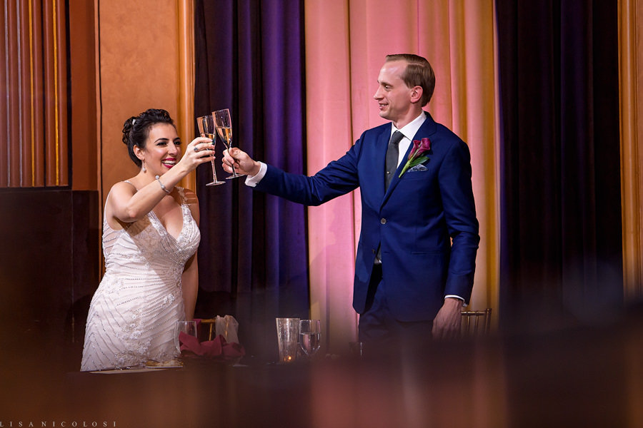 North Fork Wedding at Suffolk Theater - Bride and Groom toast