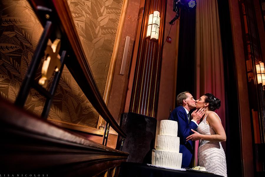 Suffolk Theater Wedding - Bride and Groom cut wedding cake - North Fork Wedding Photographer