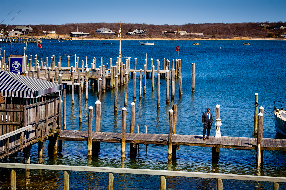 "Shooting from the bridal suite balcony it provided a gorgeous view of the docks at The Montauk Yacht Club and was the perfect location for their ""first look""."