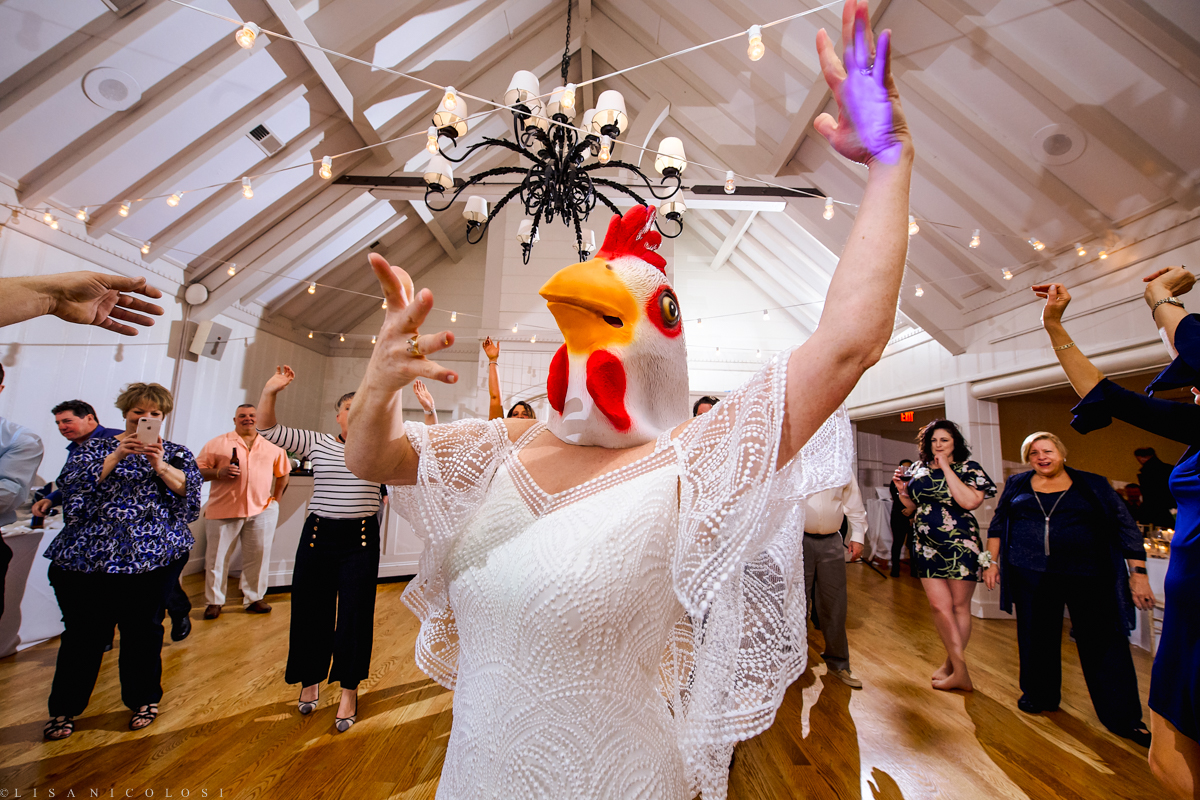 Wedding Reception at Montauk Yacht Club - Montauk Wedding Photographer - Bride wearing chicken head dancing