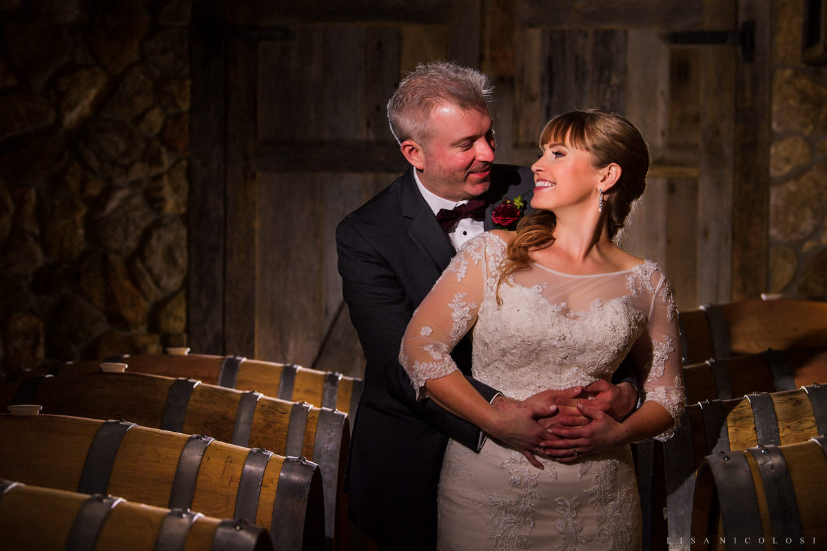 Macari Vineyard Wedding Photos of bride and groom in wine cellar - North Fork Wedding Photographer