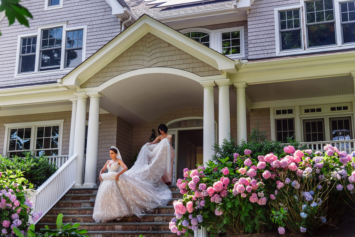Bride and bridesmaid - North Fork Wedding at private residence in Cutchogue