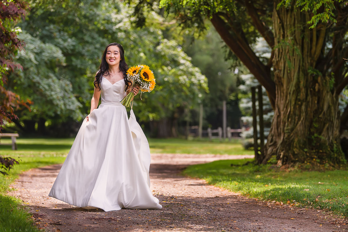 Wedding at The Old Field Vineyard - Best Long Island Wedding Photographer - Bride walking to first look