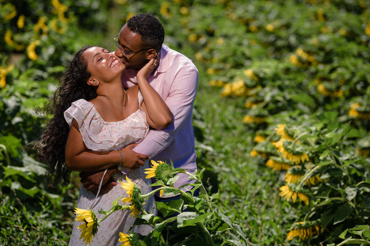 North Fork Sunflower Engagement Session in Mattituck - Romantic portrait of couple in Sunflower Field - Long Island Engagement Photographer