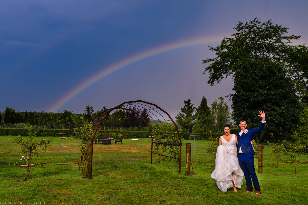 Wedding at Jamesport Manor Inn - Bride and Groom with Rainbow - North Fork Wedding Photographer