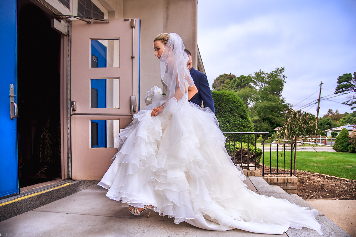 Wedding at The Larkfield - Long Island Wedding Photographer -Bride arriving to church ceremony