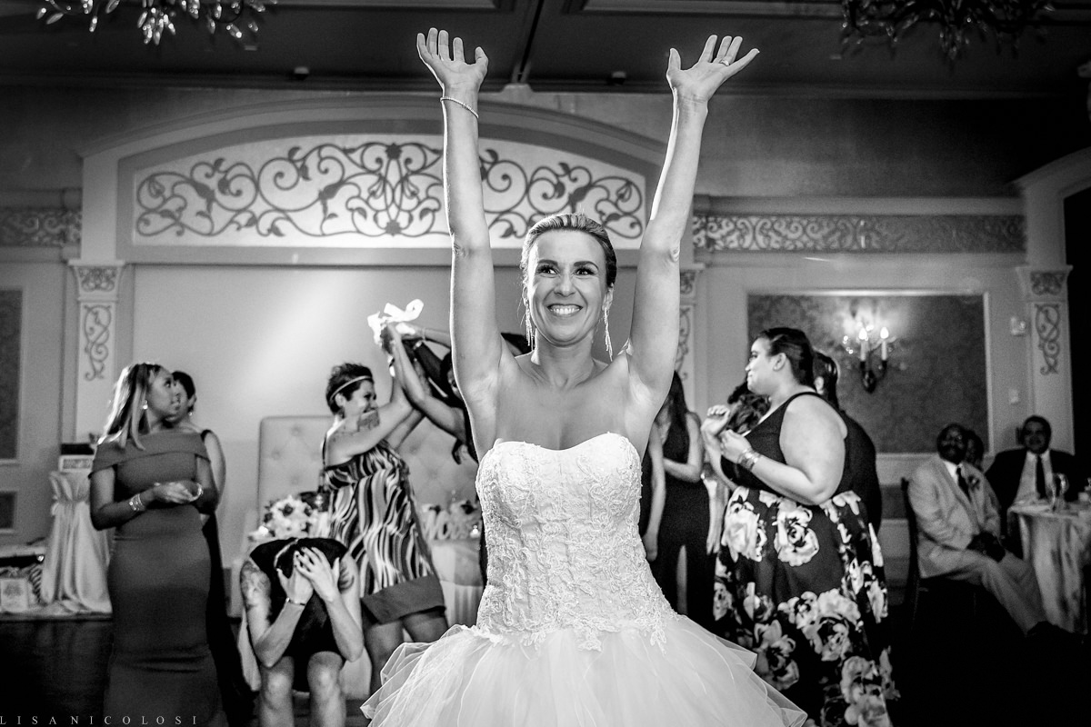 Wedding at The Larkfield - Long Island Wedding Photographer - Bride throwing bouquet