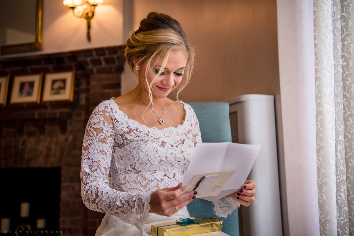 Wedding at Chateau at Coindre Hall - Long Island Wedding Photographers - Bride reading card