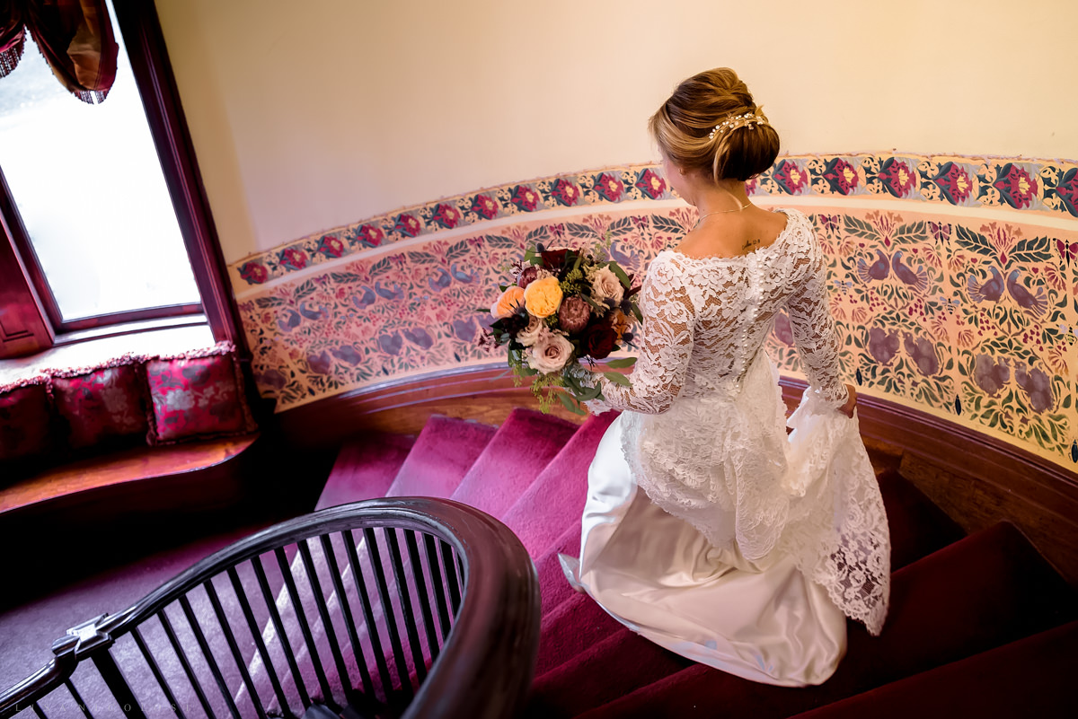 Wedding at Chateau at Coindre Hall - Long Island Wedding Photographers -bride going down staircase
