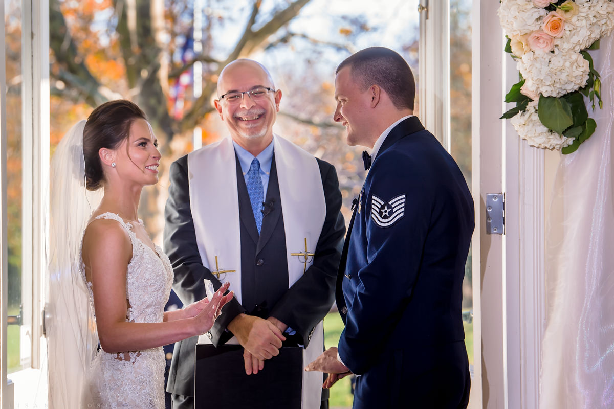 Brecknock Hall Wedding Photography - Bride and Groom exchanging wedding vows at ceremony - Greenport NY wedding