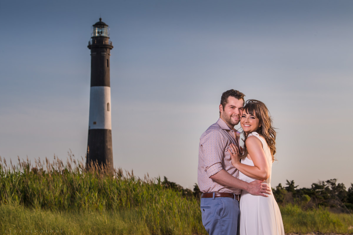 Fire Island Lighthouse Engagement Session - Engagement Portrait of couple in front of Fire Island Lighthouse
