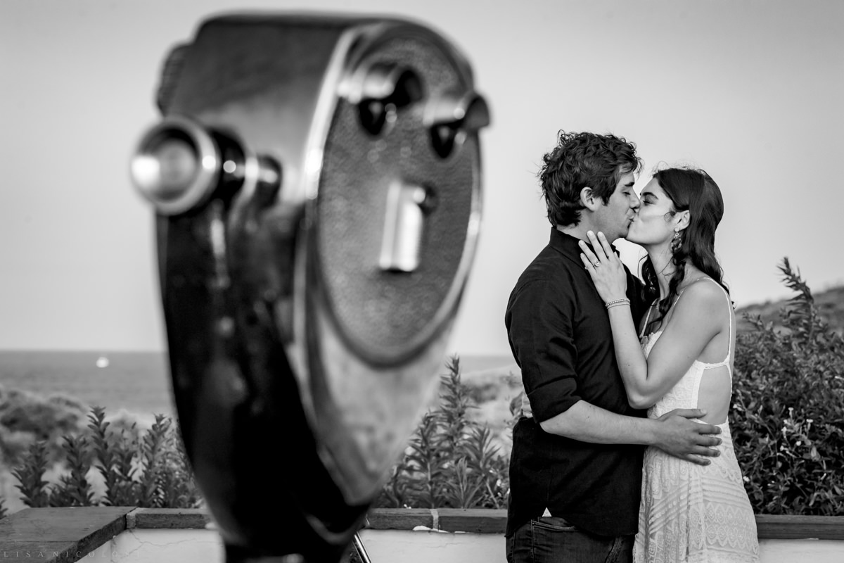 Artistic documentary Montauk Proposal and wedding photographer. black and white photo of viewer looking at the bride and groom to be.
