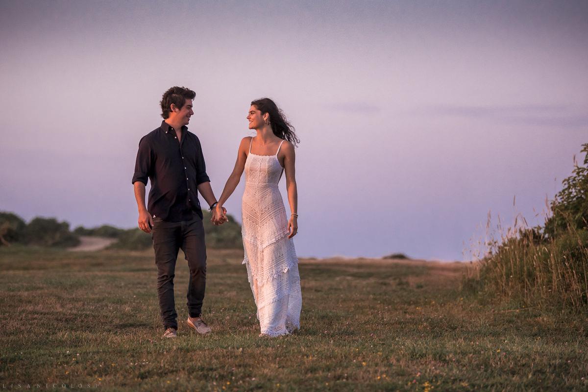 Montauk romantic engagement photos of couple walking