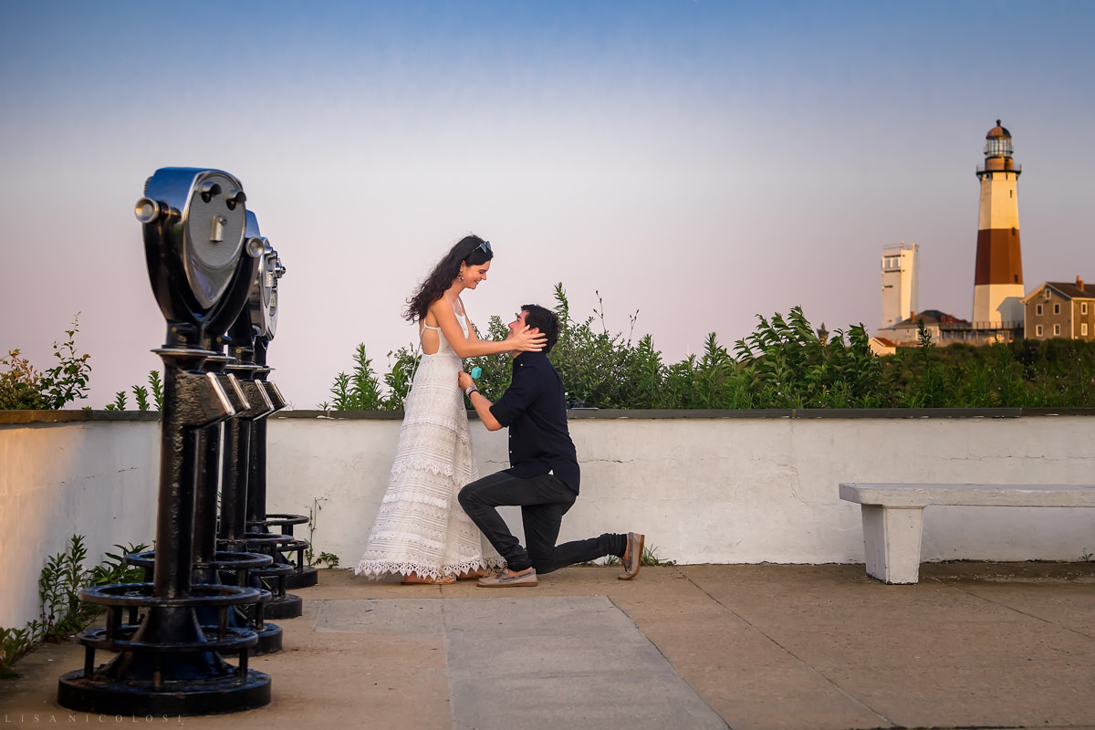 Montauk Proposal Photographer - Groom kneels and proposes at the Montauk Lighthouse