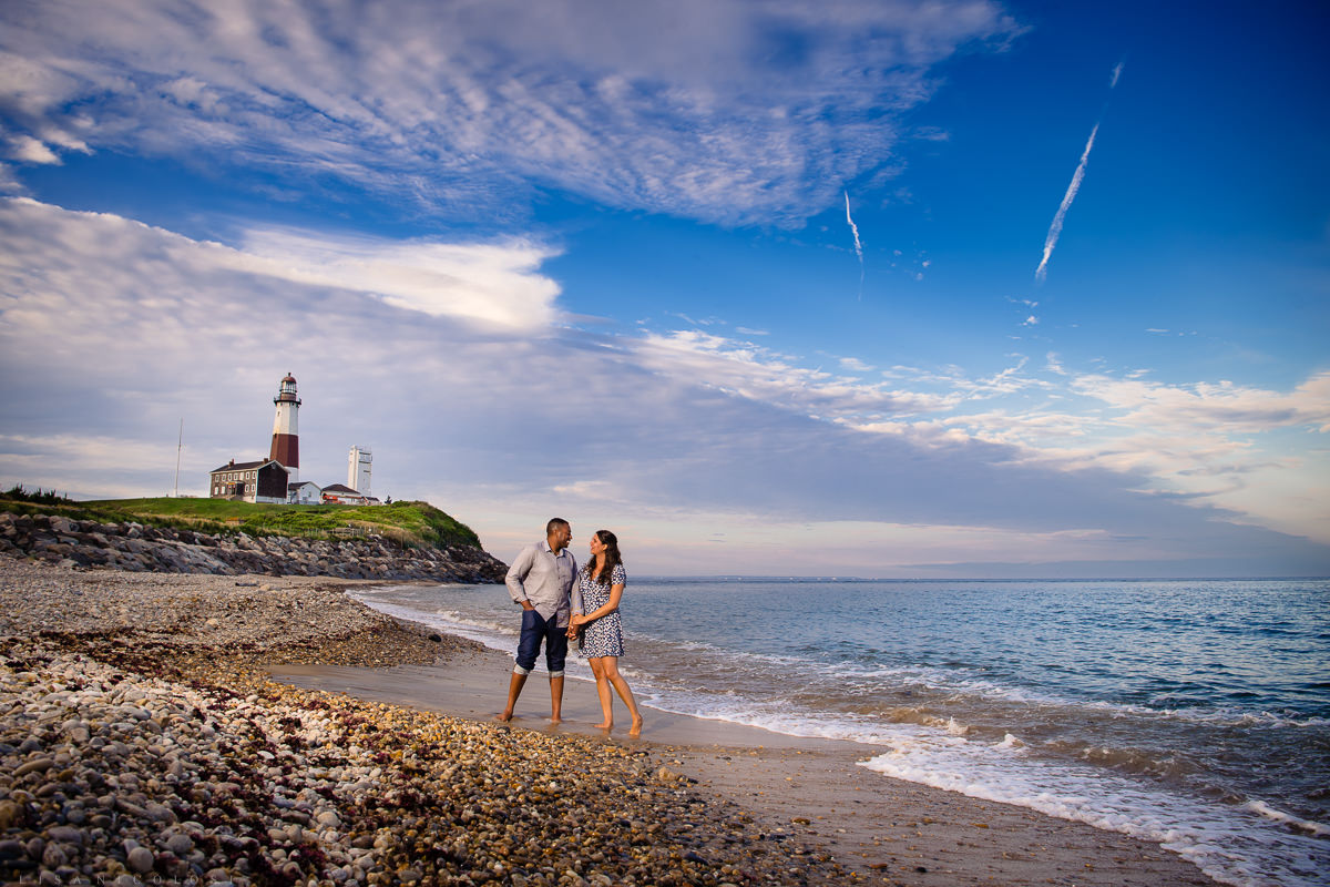 Couple portrait at seashore after marriage proposal in front of Montauk Lighthouse