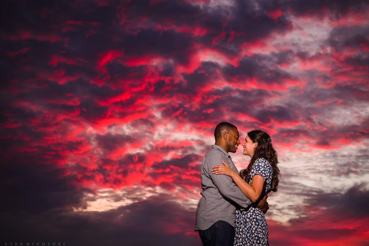 Engagement portrait of couple at sunset taken at Montauk Camp Hero State Park