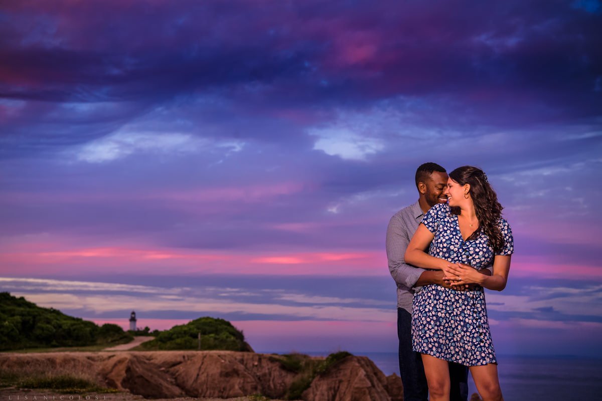 Romantic portrait of engaged couple taken at sunset on the bluffs at Montauk. Montauk Engagement session.