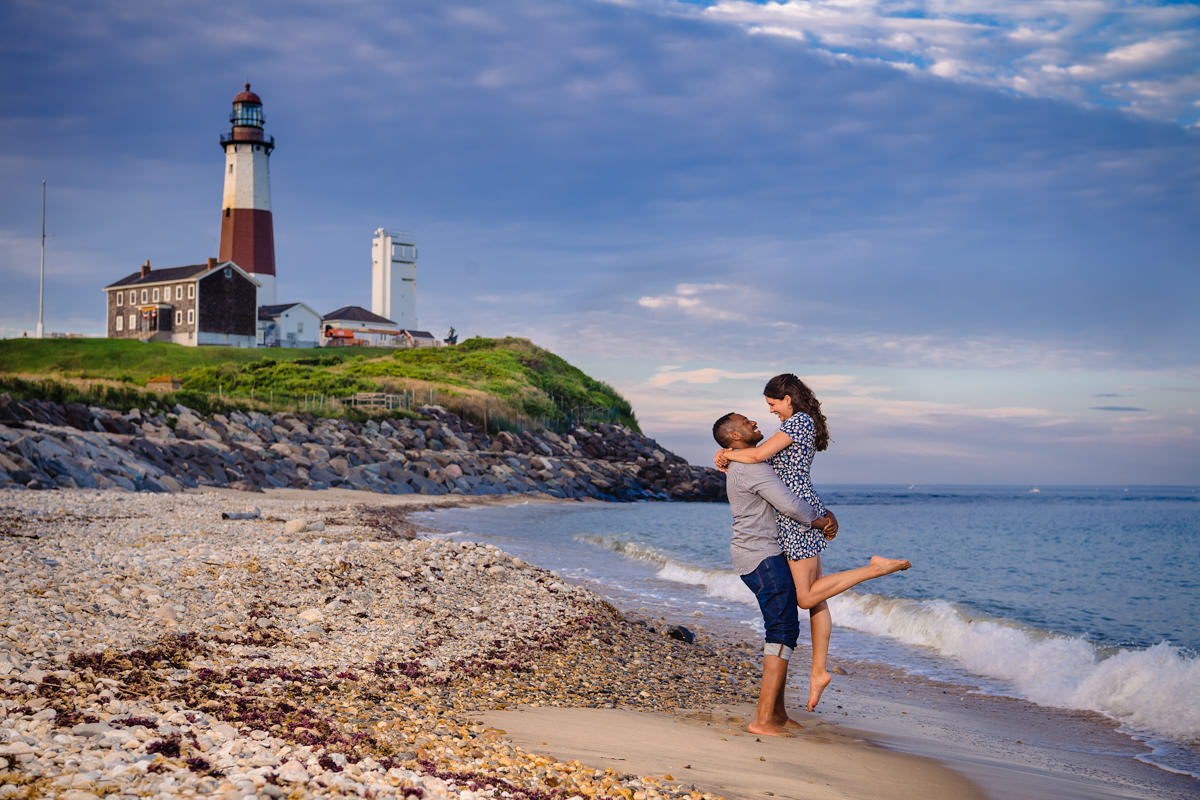 Romantic Montauk Marriage Proposal and Engagement Photos at Camp Hero State Park. Romantic portrait of groom and bride to be at the Montauk Lighthouse coastline.