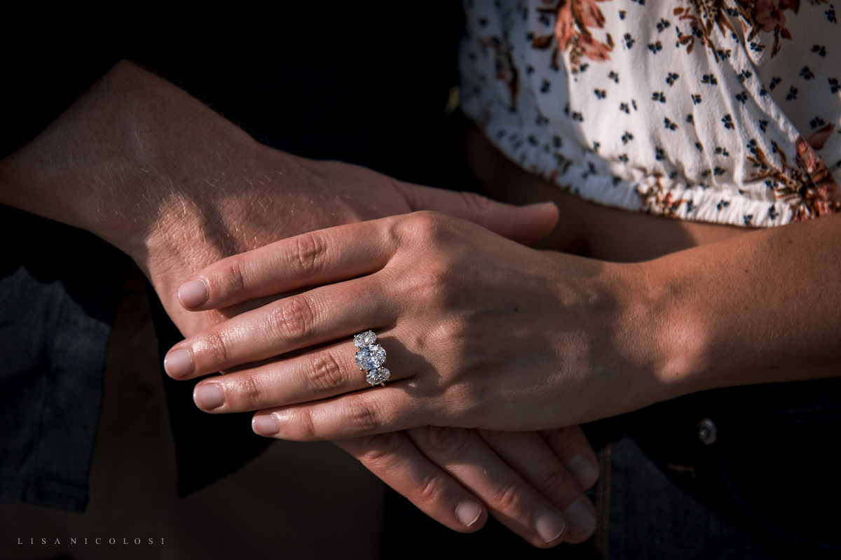 couple's hands and engagement ring