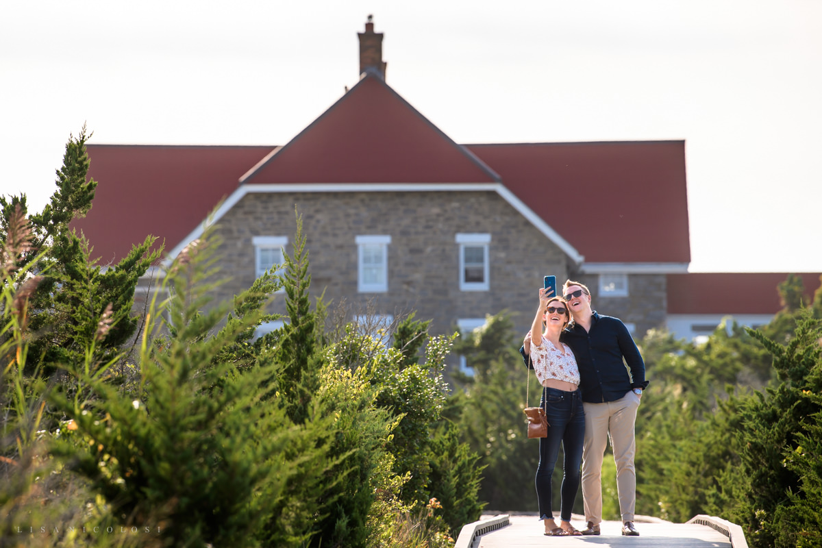 Couple taking selfie at fire island lighthouse