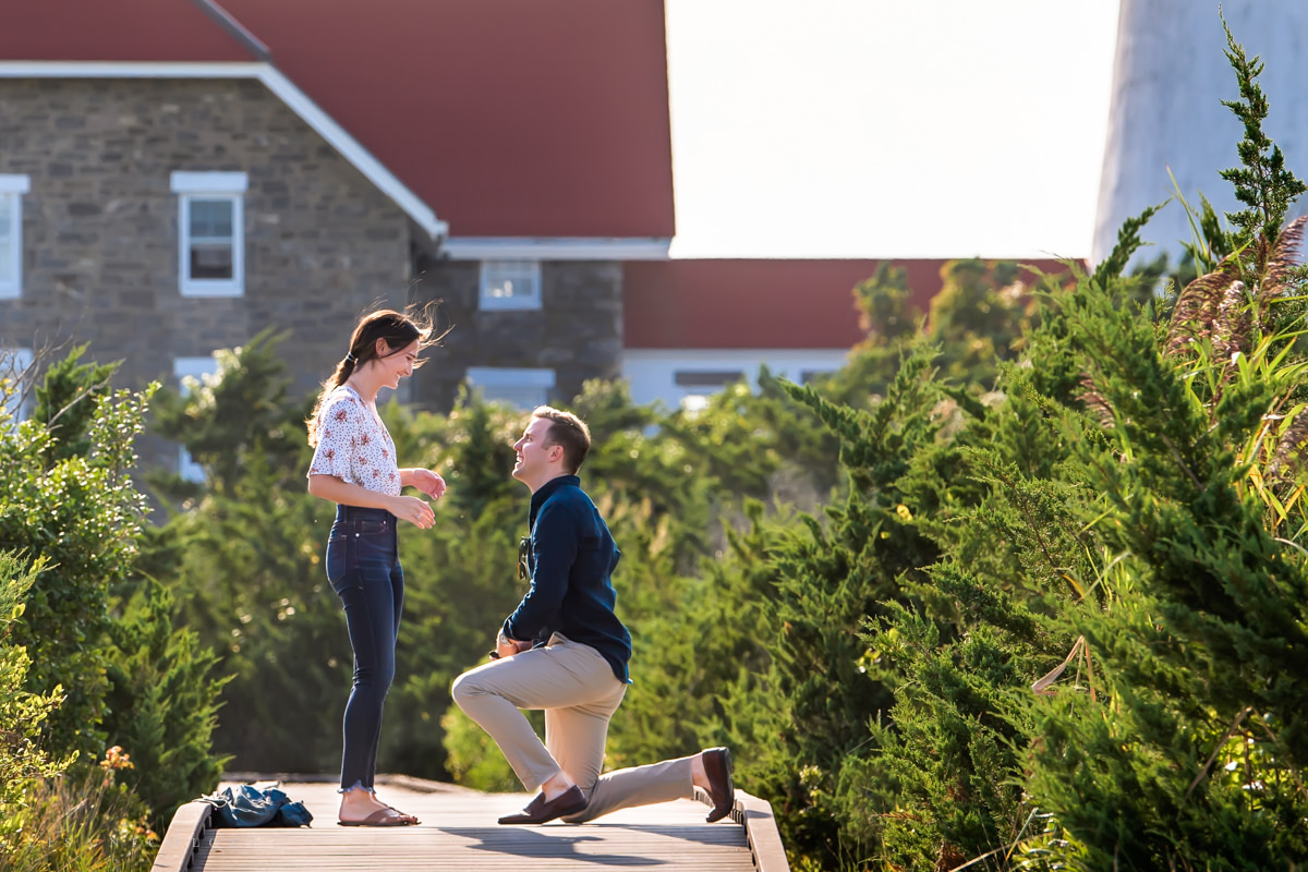 Groom to be proposing to his bride to be at the Fire Island Lighthouse