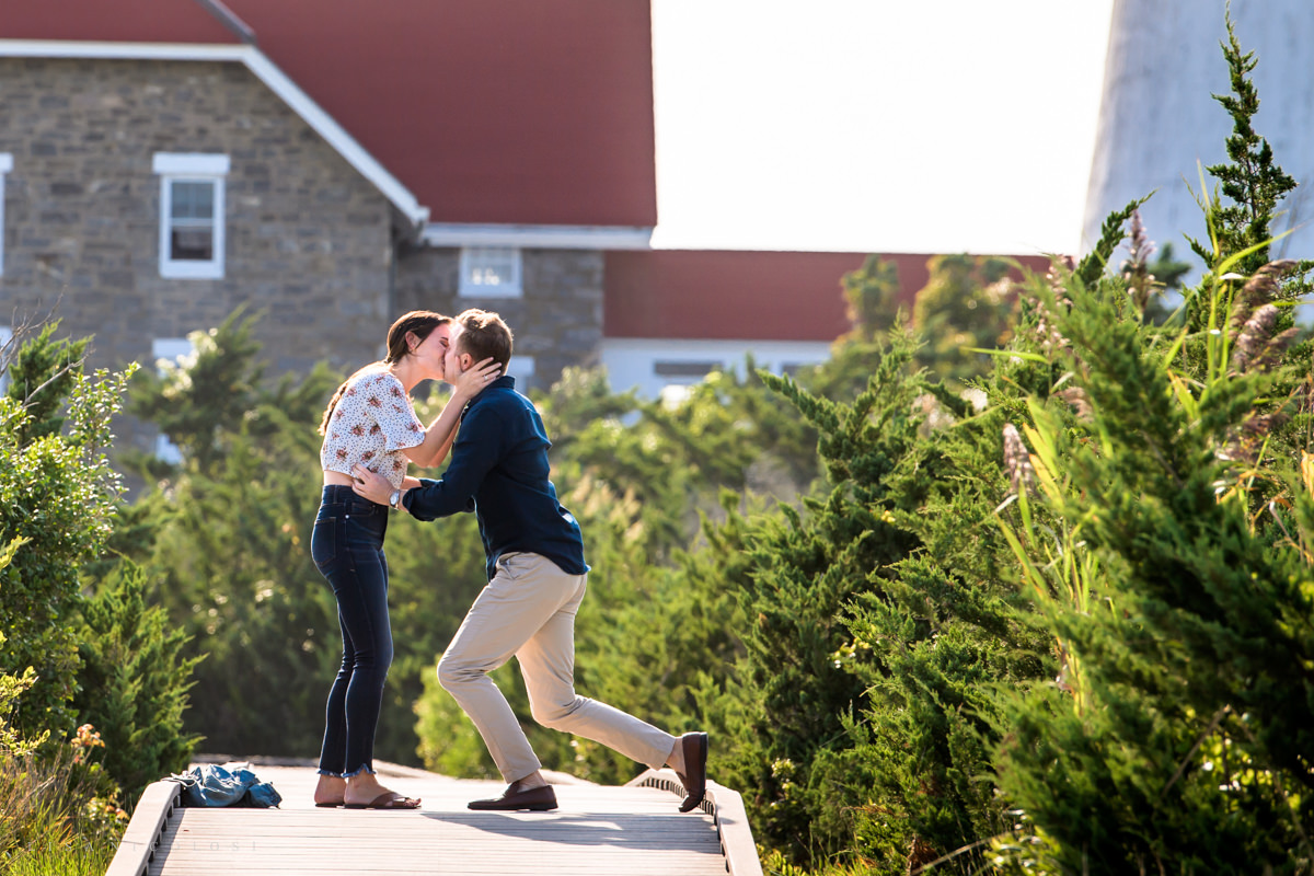 engagement kiss at Fire Island Lighthouse boardwalk
