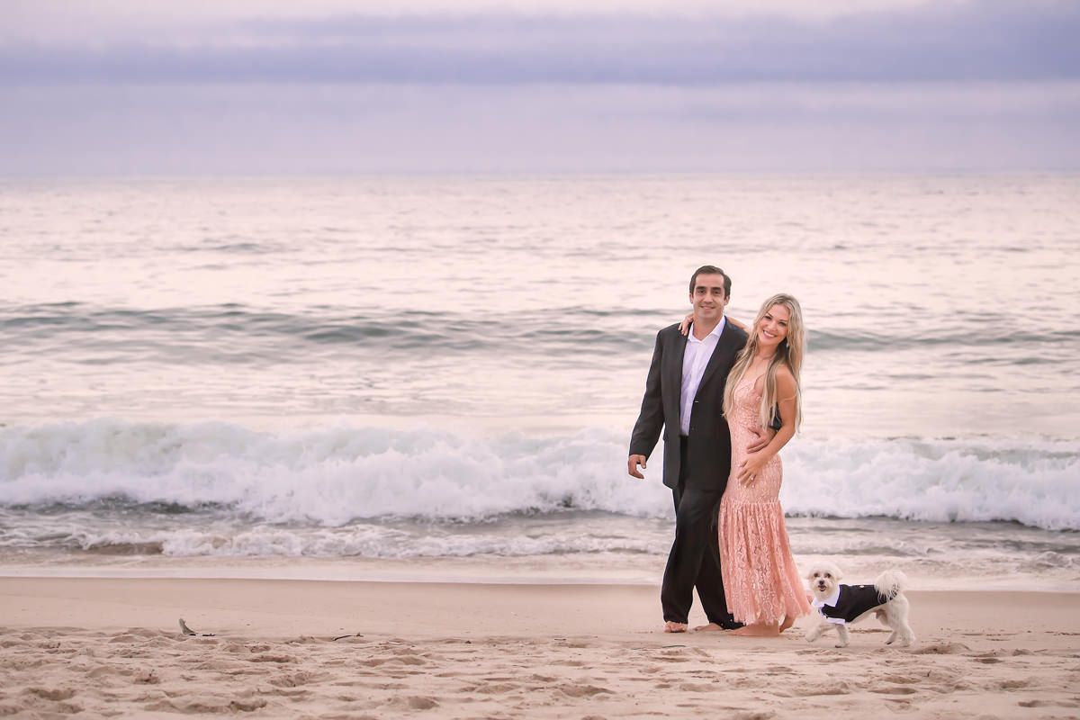Engagement portrait of groom and bride at Montauk beach with their dog