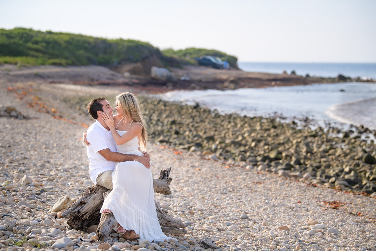 Engagement portrait of bride and groom at beach in Montauk
