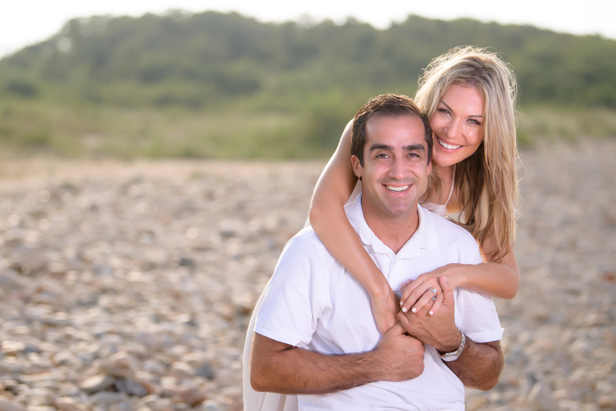 Engagement portrait of bride and groom smiling