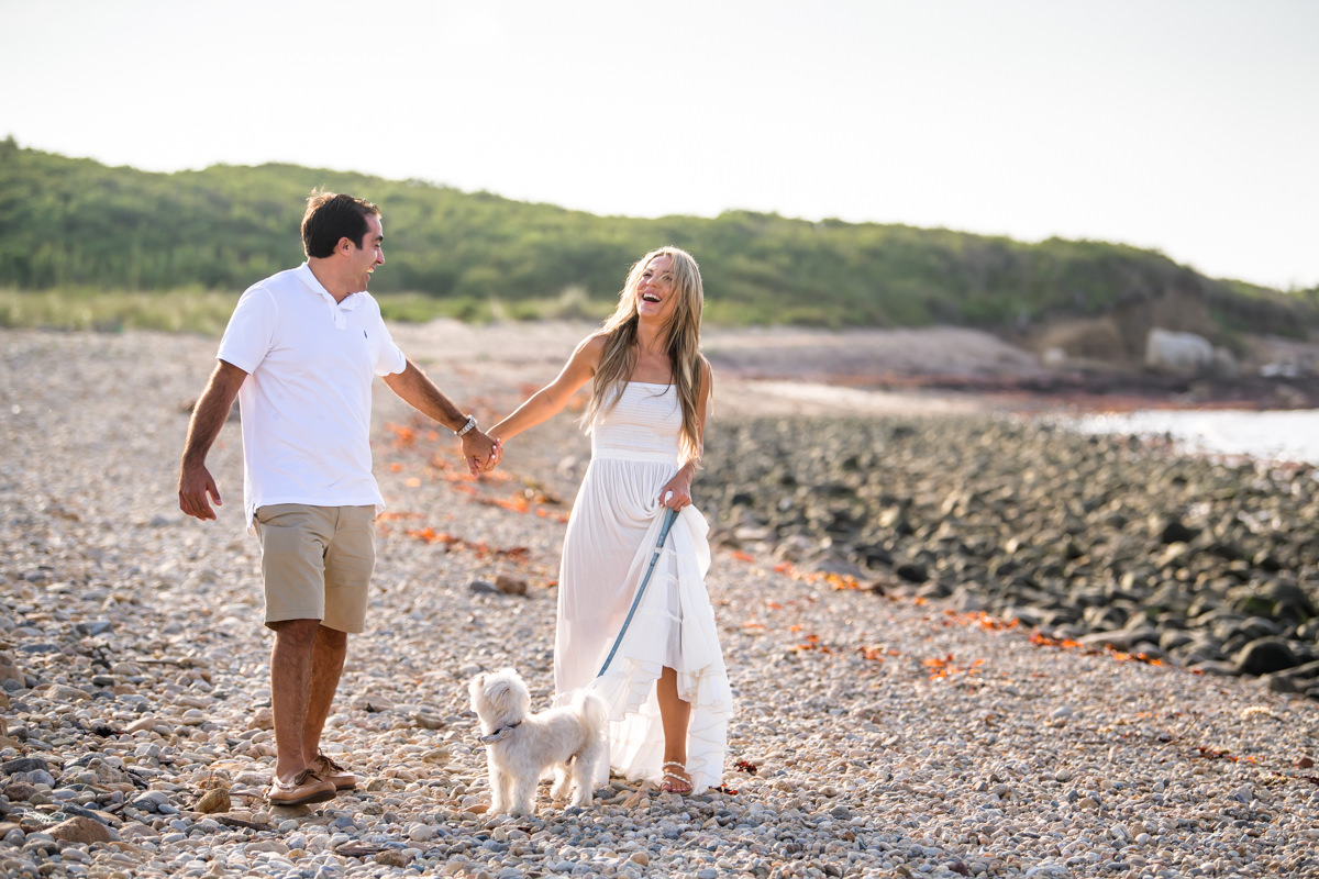 Engagement session photo of couple walking their dog