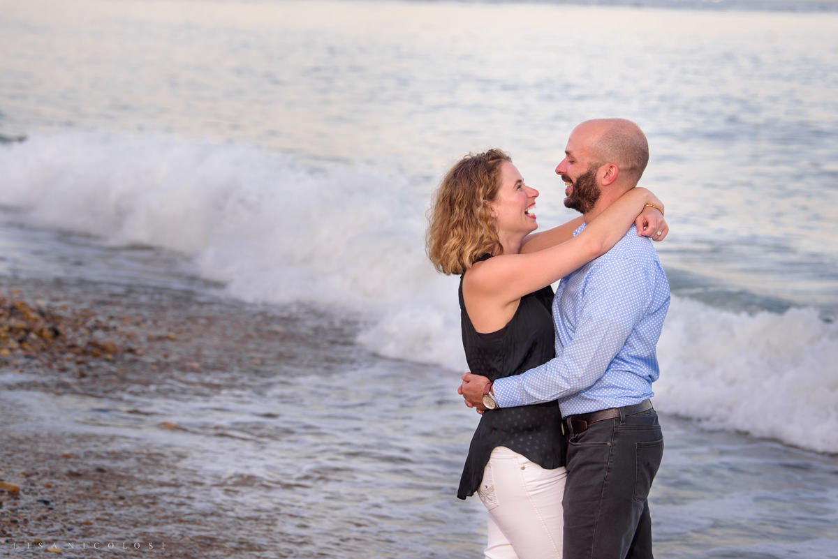 Couple hugging on Montauk beach. Montauk proposal photography.