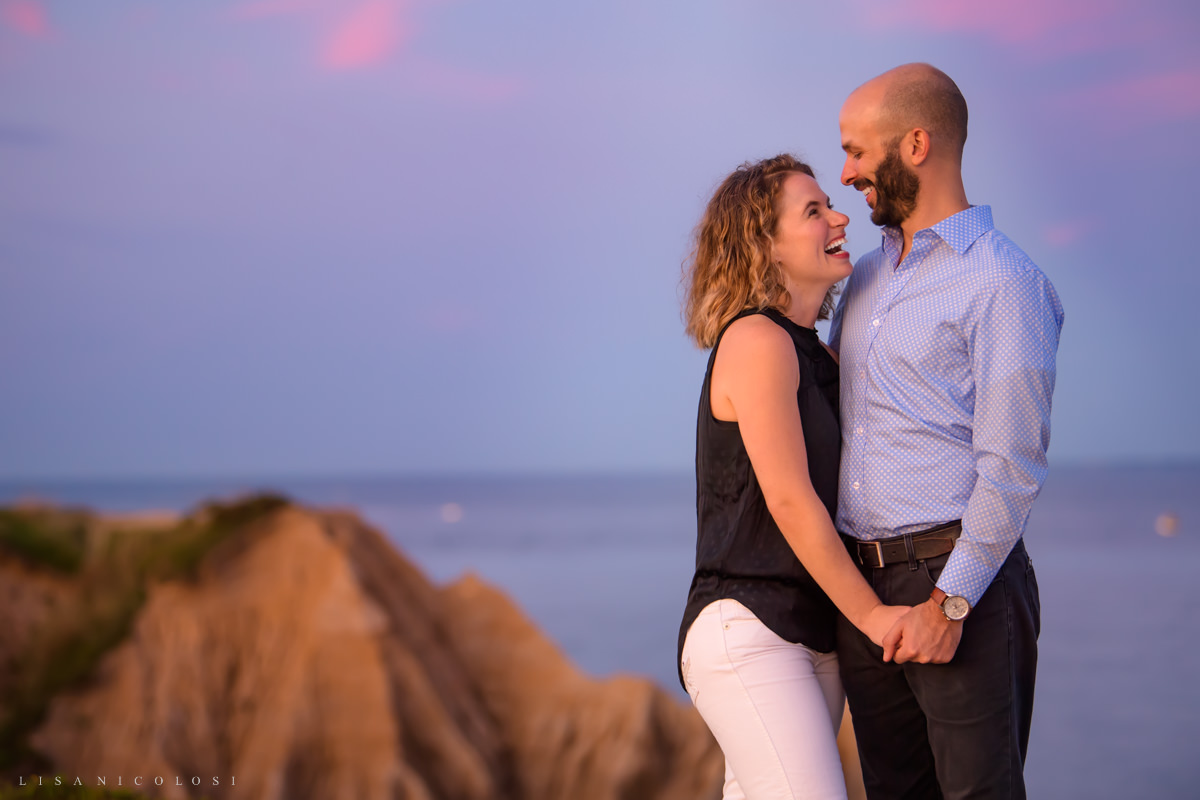 Couple hugging at sunset at Camp Hero State Park in Montauk.