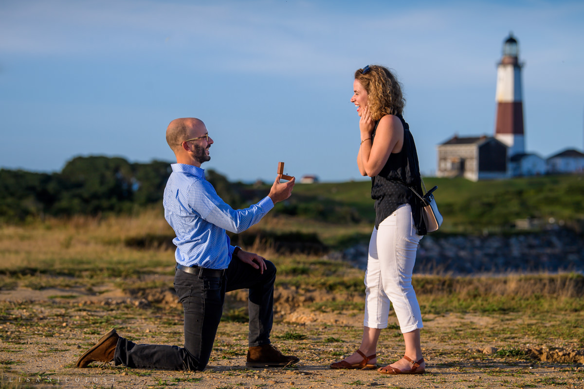 groom presents ring to girlfriend at Montauk Proposal Photography.