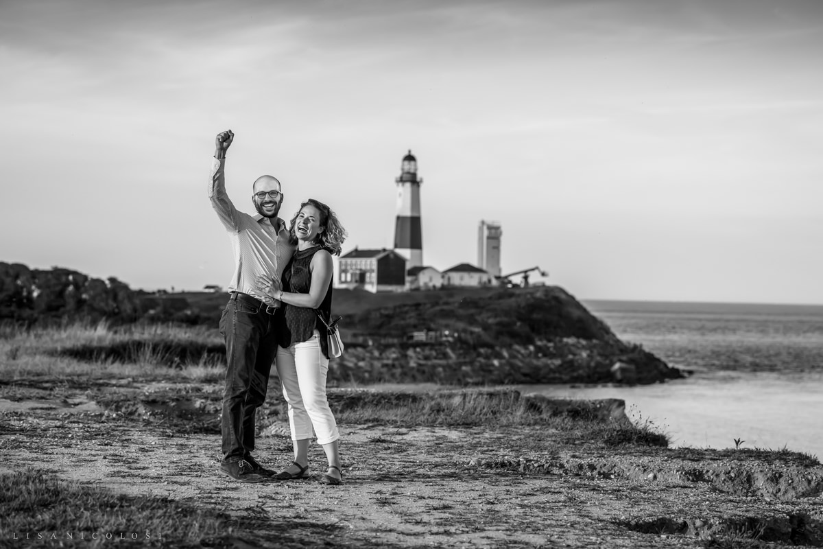 Grooms cheers and shouts after surprise Montauk Proposal.