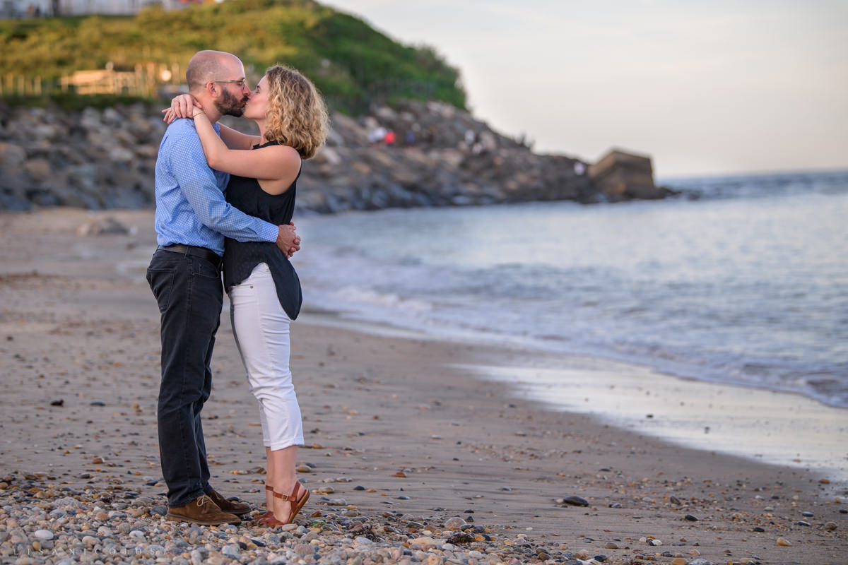 Couple kissing on beach during Montauk Engagement session