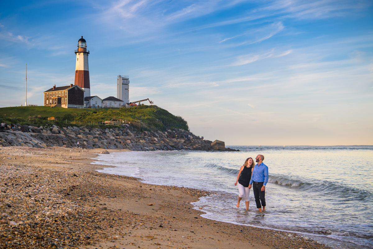 Destination Surprise Proposal Photography Session in Montauk- Couple wading in the ocean at Montauk Lighthouse after proposal.