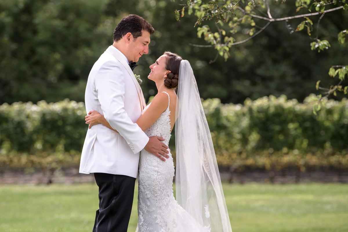 Bride and groom first look at Pellegrini Vineyards