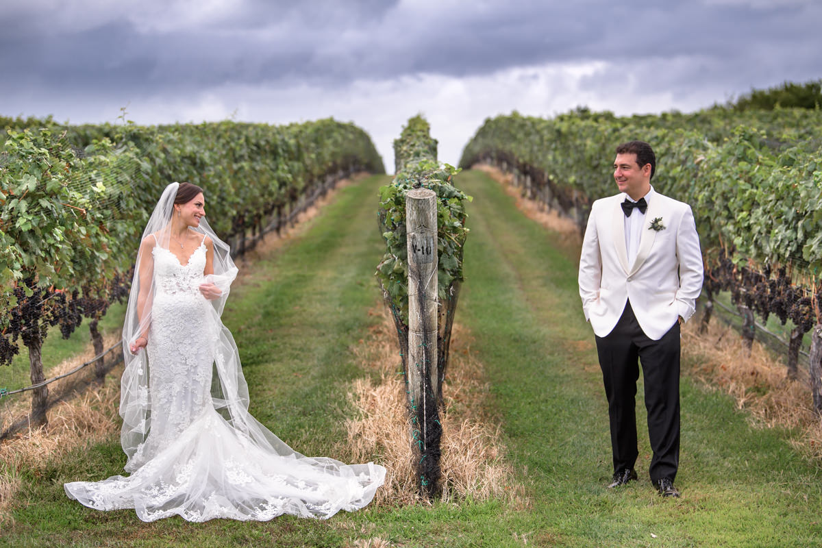 Romantic Bride and groom portrait in the vines at Pellegrini Vineyards in Cutchogue