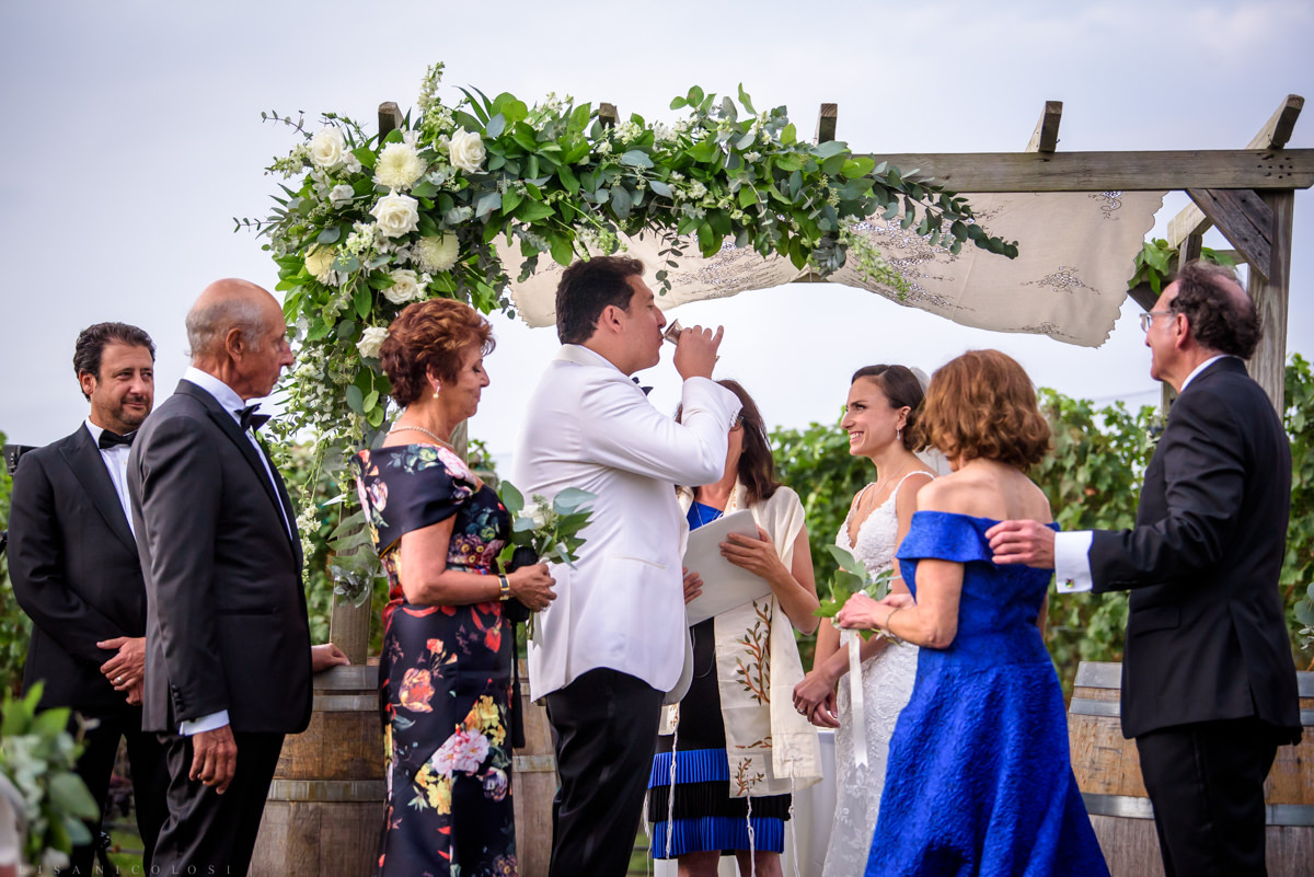 Wedding ceremony at Pellegrini Vineyards in Cutchogue -drinking from Kiddish cup