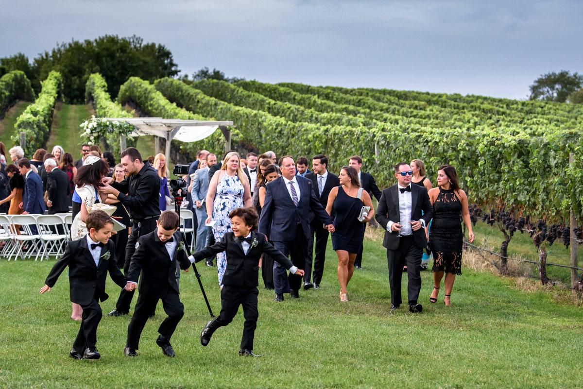 Wedding Ceremony recessional at Pellegrini Vineyards - Ring Bearers running