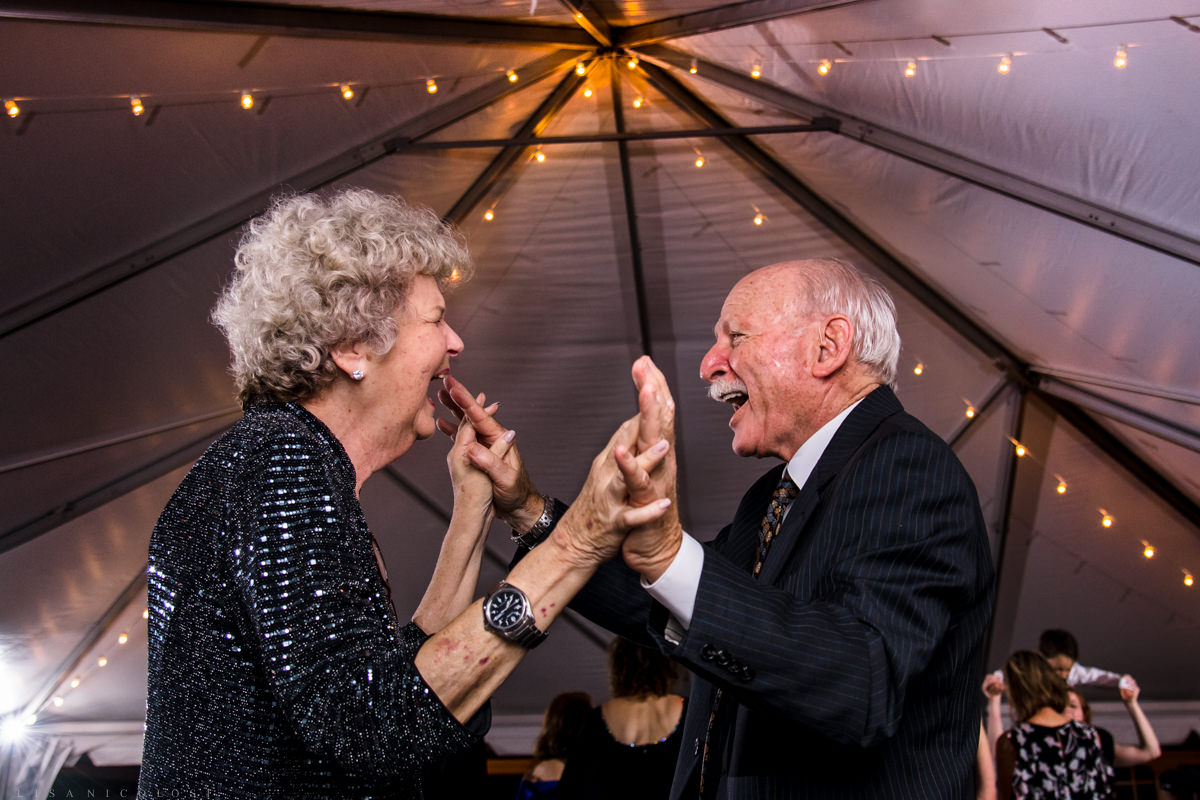 Wedding reception at Pellegrini Vineyards in Cutchogue NY- wedding guests laughing