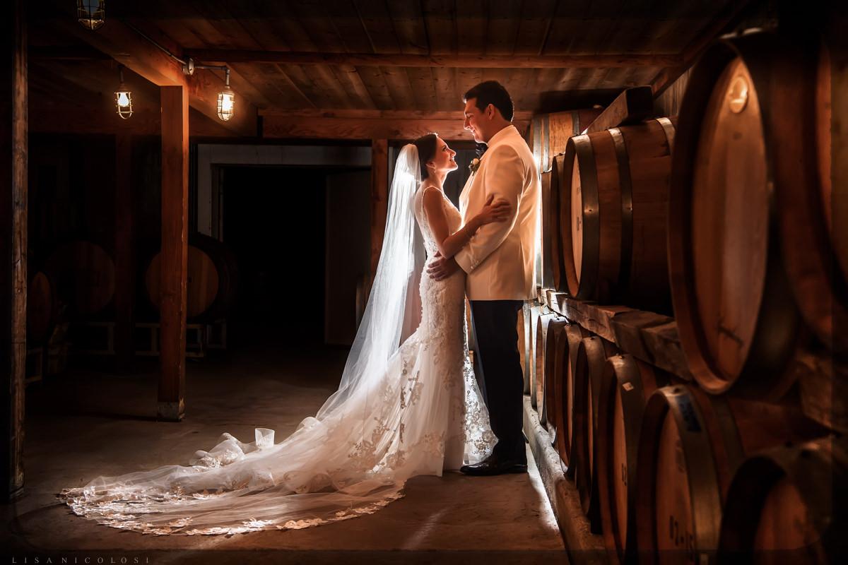 Romantic bride and groom portrait in Pellegrini Vineyards wine cellar