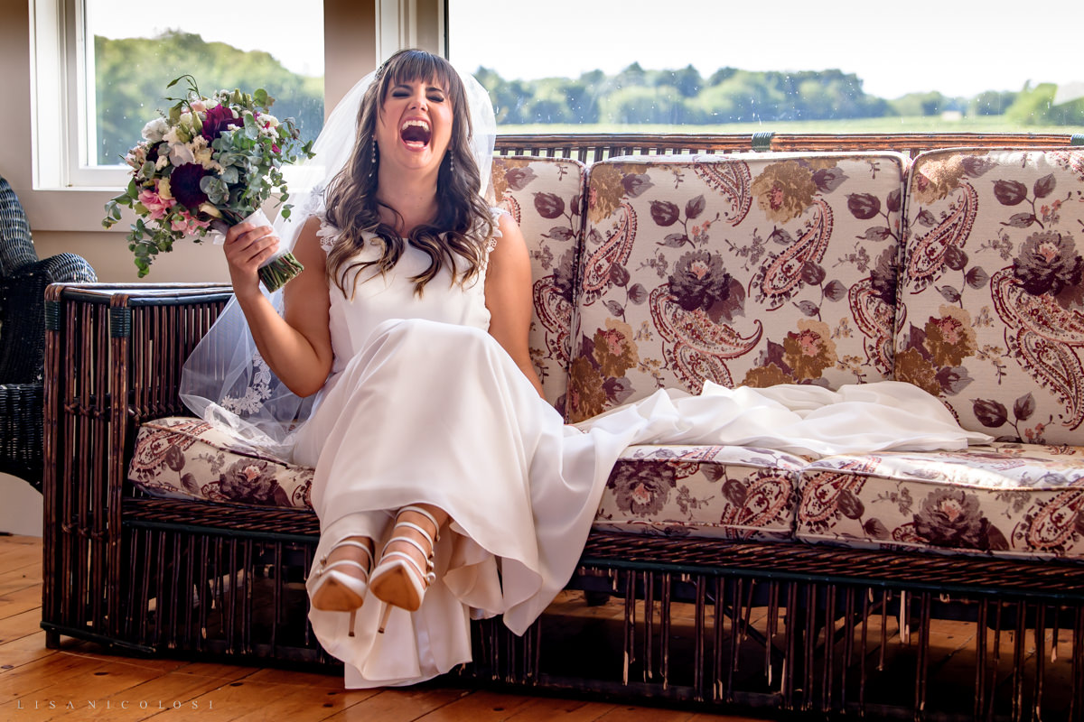 Bride laughing in bridal suite