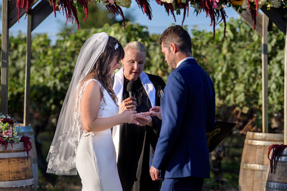 Wedding Ceremony at Pellegrini Vineyards - exchanging rings