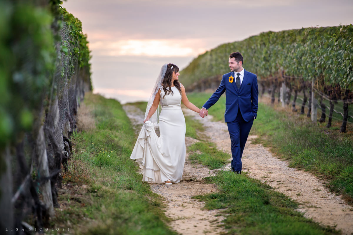 Romantic bride and groom walking at Pellegrini Vineyards