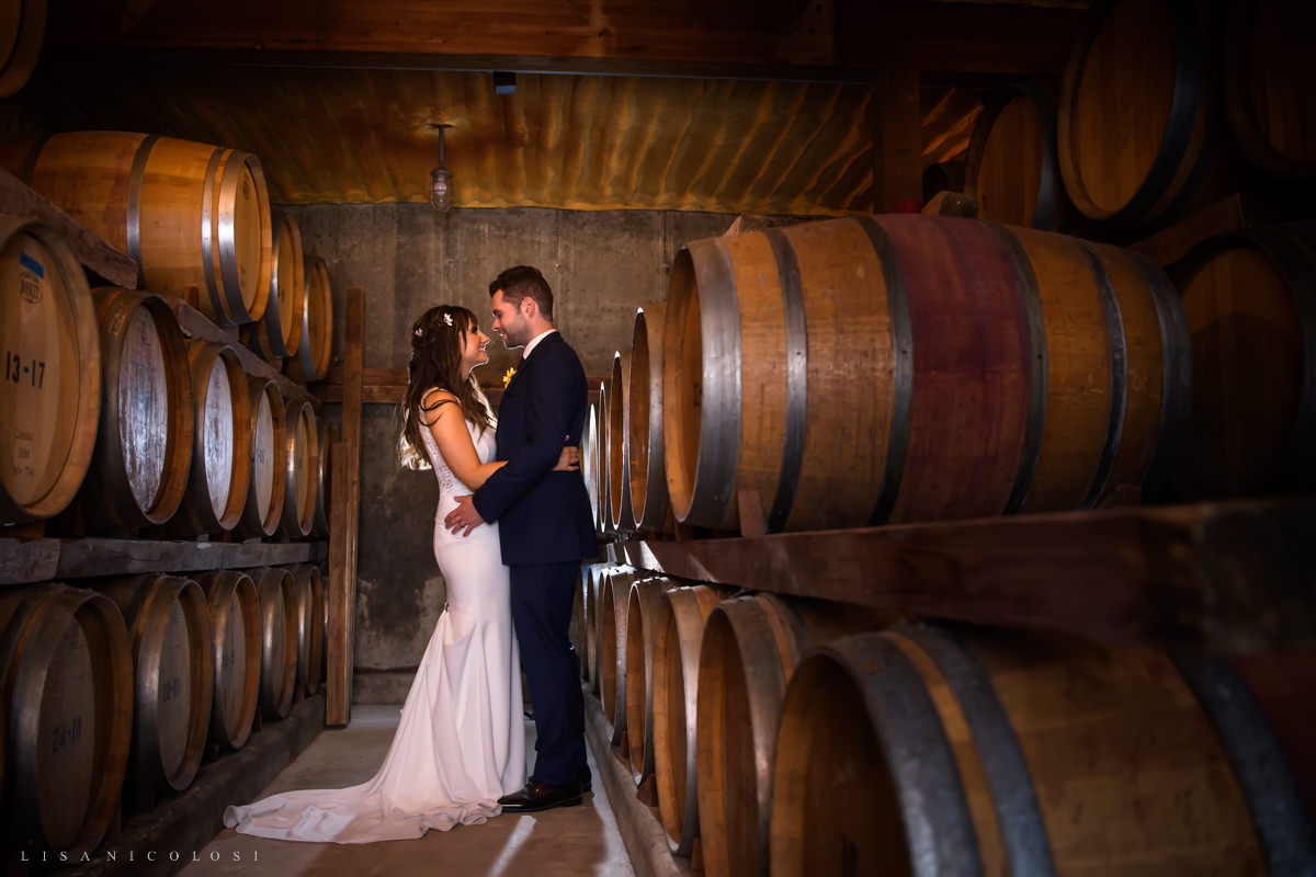 Bride and groom portrait in wine cellar at Pellegrini Vineyards