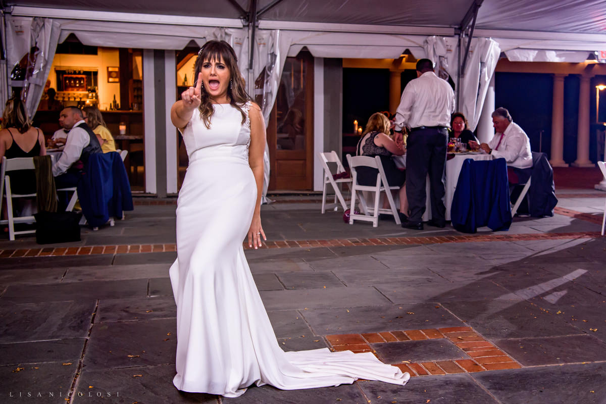 Fun wedding photos of bride dancing at pellegrini vineyards